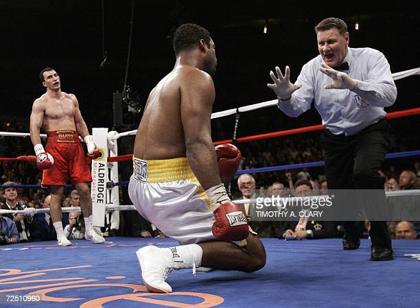 New York, UNITED STATES: Wladimir Klitschko of Ukraine goes to his corner as referee Wayne Kelly counts out Calvin Brock of the US after Klitschko...