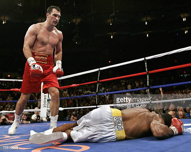 New York, UNITED STATES: Wladimir Klitschko of Ukraine watches as Calvin Brock of the US falls to the mat after Klitschko knocked him out in the...