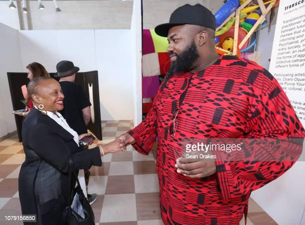 New York University professor Deborah Willis meets artist Alfred Amadu Conteh at PRIZM Art Fair as part of the 2018 Art Basel Miami Beach art fair on...