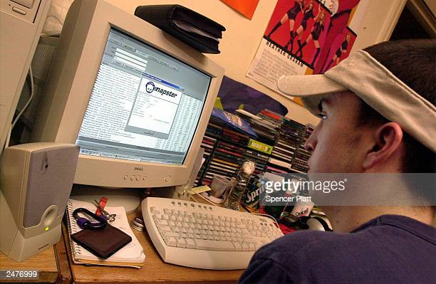 A New York University student downloads music from the Napster site March 6 2001 in New York City The Recording Industry Association of America filed...