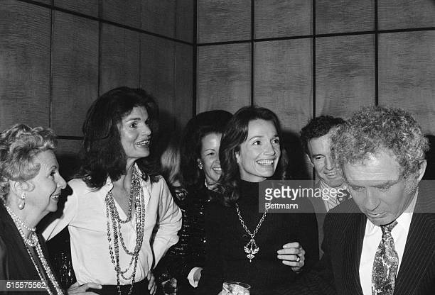 Unscheduled guest Jacqueline Kennedy Onassis shares the spotlight with her younger sister Lee Radwizill at small private party given here Dec 19 for...