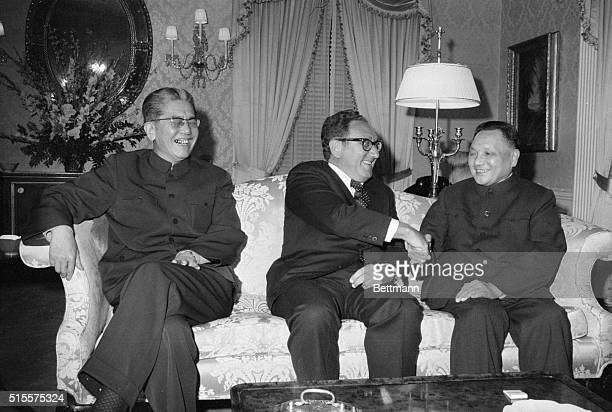 New York: US Secretary of State Henry Kissinger chats with Vice Premier Deng Xiaoping of China at a dinner here 4/14. Deng is the highest-ranking...
