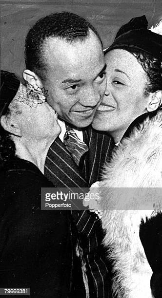 New York USA 31st August 1936 Wonder athlete Jesse Owens is kissed upon arrival in New York aboard the liner Queen Mary by his mother and his wife...