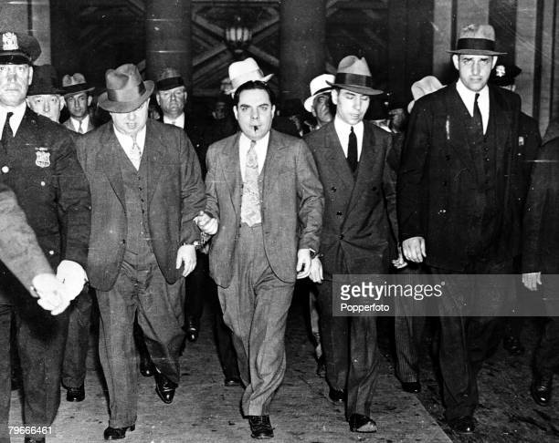New York USA June 1936 American Gangster Charles Lucky Luciano being led from a New York court by a posse of detectives to start a sentence of 3050...