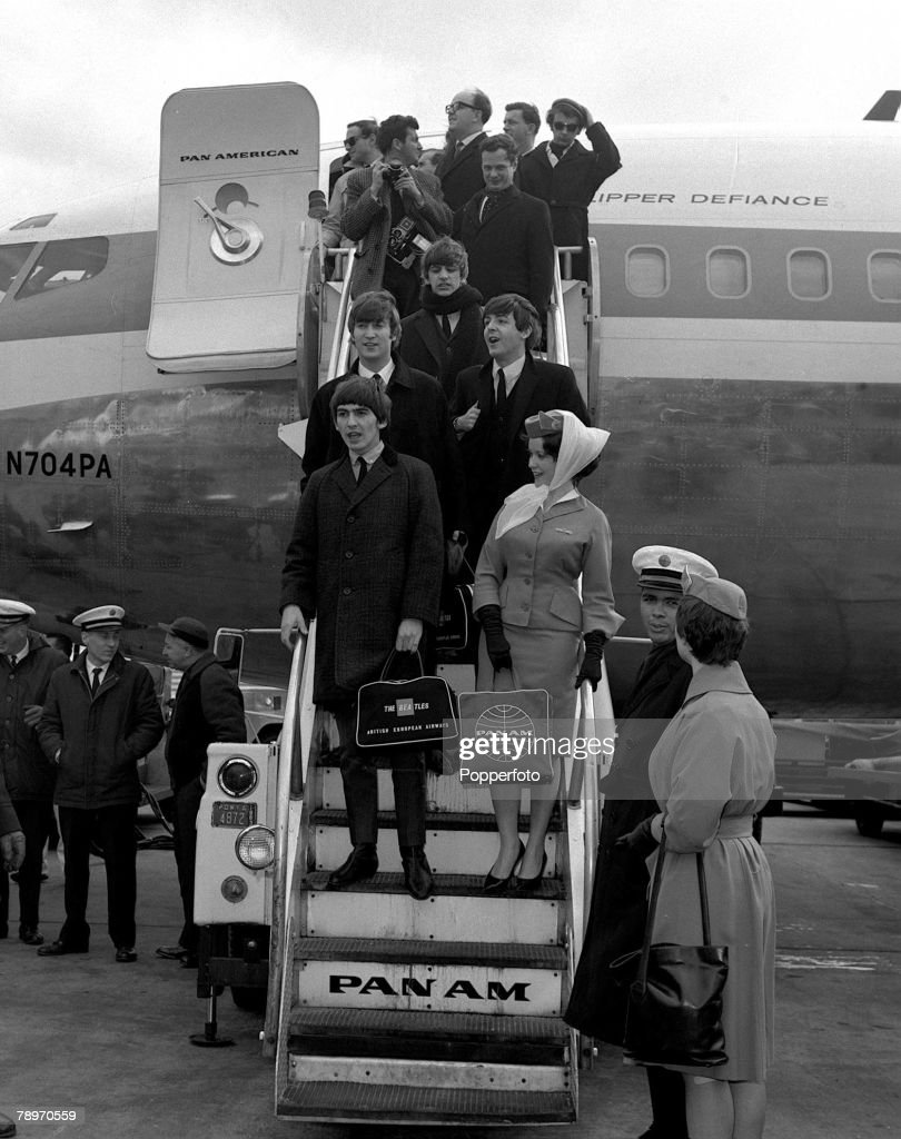 New York, USA, 1964. Members of the British pop group The Beatles descend from the plane at the airport as they arrive in New York for their tour of the USA. : News Photo