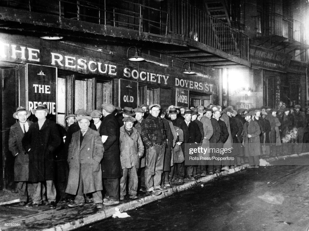 New York, USA 1931. New Yorkers celebrated Christmas in 1931, with a city-wide solicitude for those touched by misfortune during the year. The Municipal Lodging House fed 10,000 persons, including about 100 women and the Police Glee Club and the Police B : News Photo