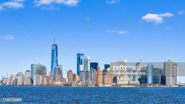 new york, usa, urban skyline seen from a cruise ship - lower manhattan stock pictures, royalty-free photos & images