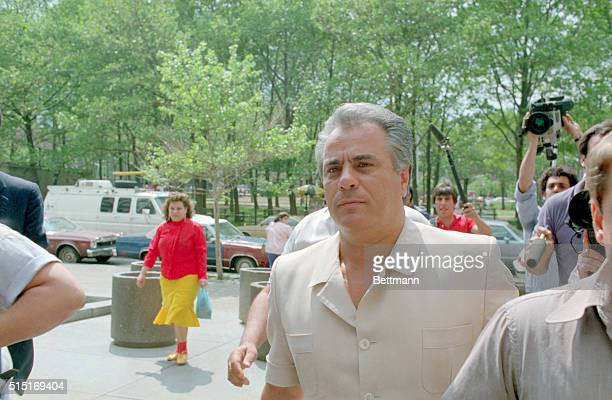 Wearing a tan safari suit reputed Gambino family godfather John Gotti arrives at the US District Court in Brooklyn where he surrendered to federal...