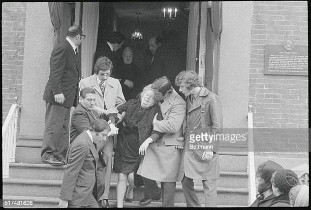 With anguished crys of My Baby My Baby Joseph Crazy Joe Gallo's Mother is helped from a Brooklyn funeral home by an unidentified man Joe Murdered...