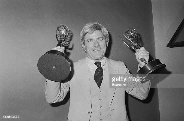 With Marlo Thomas at his side Phil Donahue holds Emmy he received as Outstanding Host 5/17 here when the National Academy of Television Arts and...