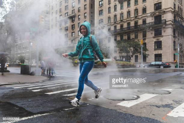 usa, new york, woman in the city on a rainy day - sportswear stock pictures, royalty-free photos & images