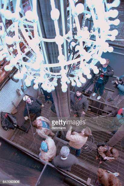 Workers from the Artkraft Strauss Sign Corp rehearse the traditional lowering of the ball on the roof on One Times Square The ball which will be...