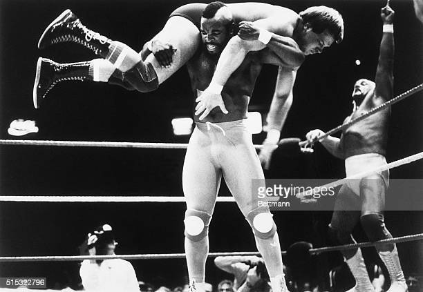 New York: Wrestling champion Hulk Hogan shows enthusiasm as television's Mr. T, his partner in a tag team wrestling match, gets Rowdy Roddy Piper up...