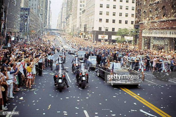 Apollo 11 astronauts left to right Buzz Aldrin Michael Collins and Neil Armstrong wave to crowds on 42nd Street in open car while on the way to...