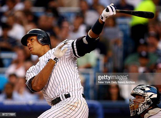 New York Yakees third baseman Alex Rodriguez connects for a 2 run home run in the 3rd inning of the Yankees game against the Toronto Blue Jays at...