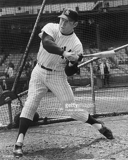 New York Yankee baseball player Mickey Mantle prepares to take a swing in front of a batting cage during the 1967 baseball season He wears his uniform