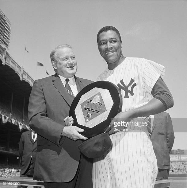 New York Yankee catcher Elston Howard receives the American League's 1963 Most Valuable Player Award from league president Joe Cronin before the...