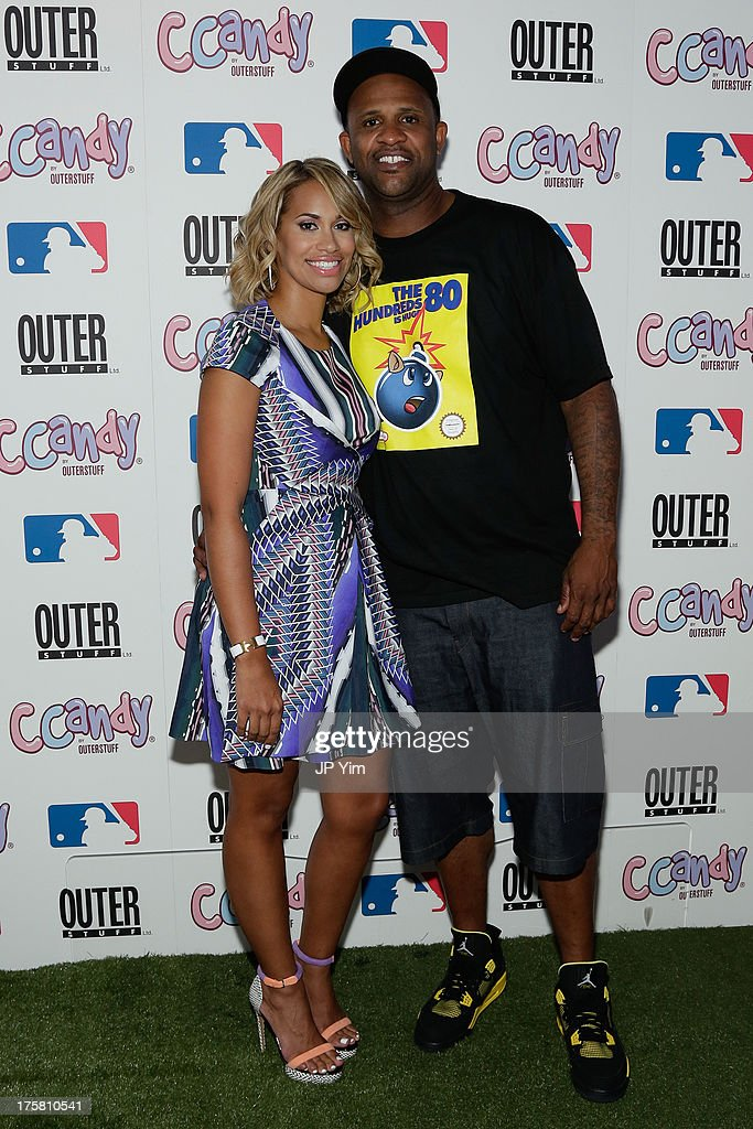 New York Yankee CC Sabathia and Amber Sabathia attend the CCandy Children's Clothing Line Launch at MLB Fan Cave on August 8, 2013 in New York City.