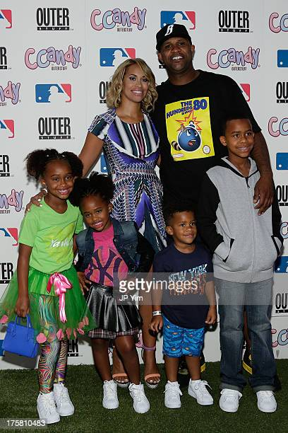 New York Yankee CC Sabathia his wife Amber Sabathia and Jaeden Arie Cyia Carter and CC III attend the CCandy Children's Clothing Line Launch at MLB...