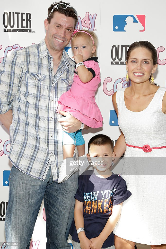 New York Yankee Chris Stewart, his wife Lindsey and daughter Brooklyn Jean and son Sebastian Carter attend the CCandy Children's Clothing Line Launch at MLB Fan Cave on August 8, 2013 in New York City.