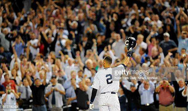 New York Yankee Derek Jeter tips his helmet to adoring crowd after tying Lou Gehrig's team hits record in 7th inning during game against Tampa Bay...