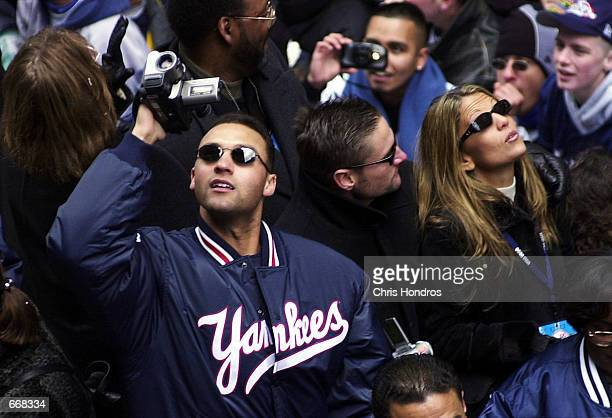 New York Yankee Derek Jeter videotapes the crowd from his float October 30 2000 during the Yankees'' World Series victory parade in New York City The...