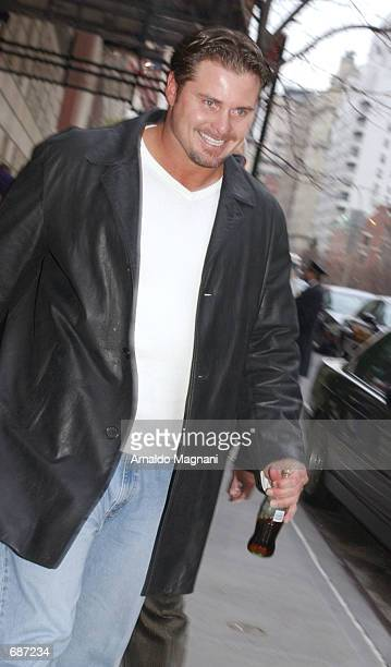 New York Yankee first baseman Jason Giambi hurries down the street December 12 2001 in New York City Giambi and his fiancee Kristian Rice are set to...