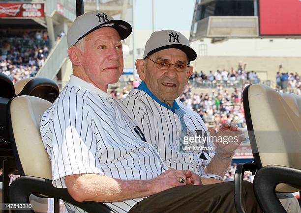 New York Yankee Hall of Famers Whitey Ford and Yogi Berra are introduced during the Yankees 66th Annual Old Timers day prior to the game against the...