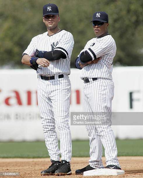 New York Yankee infielders Derek Jeter and Robinson Cano look into the stands in a spring training game against the Twins on March 1 2007 at Legends...