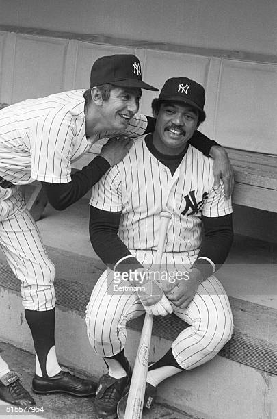 New York Yankee manager Billy Martin puts arms around his newlyacquired superstar Reggie Jackson as they meet in the dugout prior to the April 20...