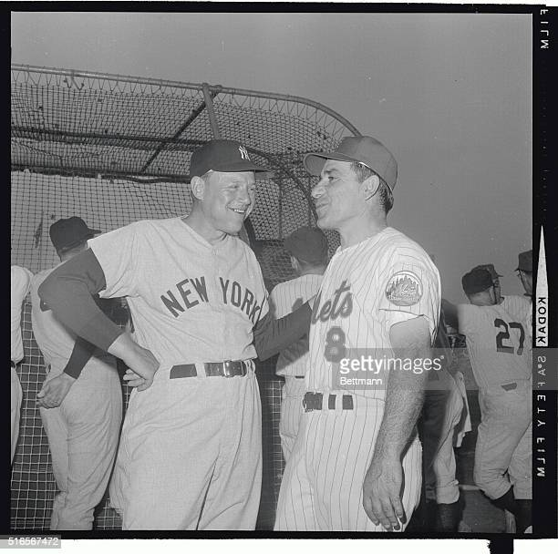 New York Yankee manager Ralph Houk gets together with former Yankee manager and now first base coach for the Mets Yogi Berra prior to the start of...