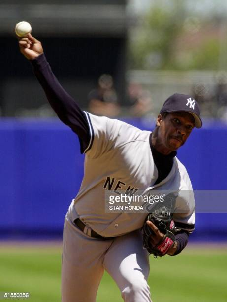 New York Yankee pitcher Dwight Gooden throws a pitch in the first inning of game against the New York Mets 08 July at Shea Stadium in New York The...