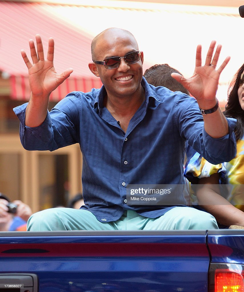 New York Yankee pitcher Mariano Rivera waves to fans as he passes by during the MLB All-Star Game Red Carpet Show on July 16, 2013 in New York City.