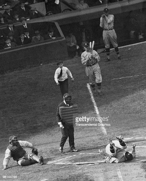New York Yankee pitcher Waite Hoyt has just hit Washington Senators batter Earl Smith with a pitch, catcher Wally Schang is on his butt, Senators...