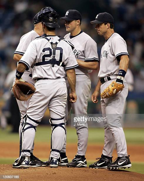 New York Yankee players surround starting pitcher Al Lieter as they have a meeting on the mound in Wednesday night's game against the Tampa Bay Devil...