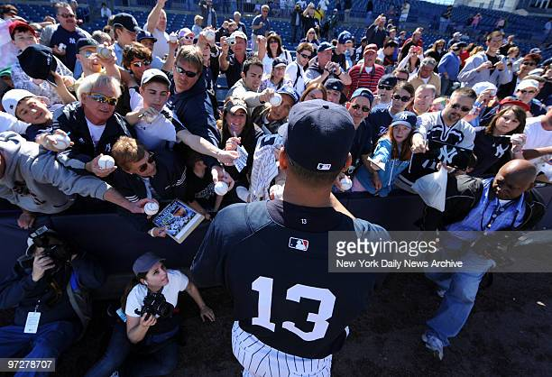 New York Yankees 3rd baseman Alex Rodriguez signs autographs during Saturday workout Spring Training 2009