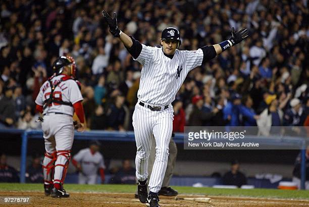 New York Yankees' Aaron Boone celebrates as he runs the bases after hitting the game winning home run in the 11th inning of Game 7 of the American...
