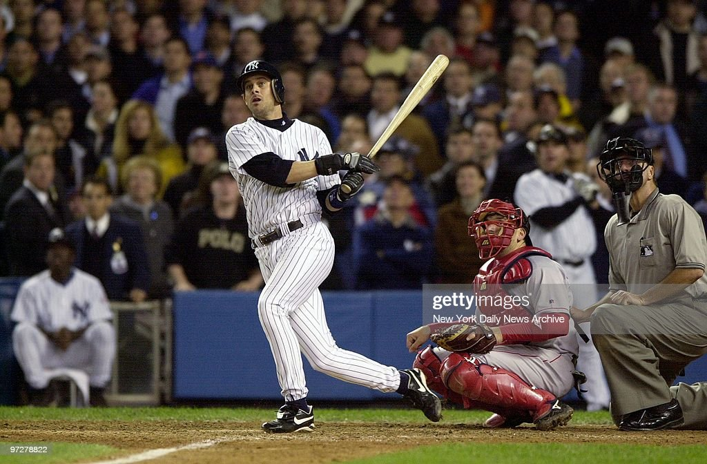 New York Yankees' Aaron Boone hits a solo home run in the 11th inning of Game 7 of the American League Championship Series against the Boston Red Sox at Yankee Stadium. The Yanks won the championship and advance to the World Series.