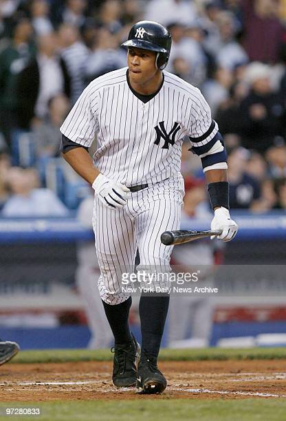 New York Yankees' Alex Rodriguez begins his homerun trot after crushing a tworun shot off the upper deck facade in left field in the third inning of...