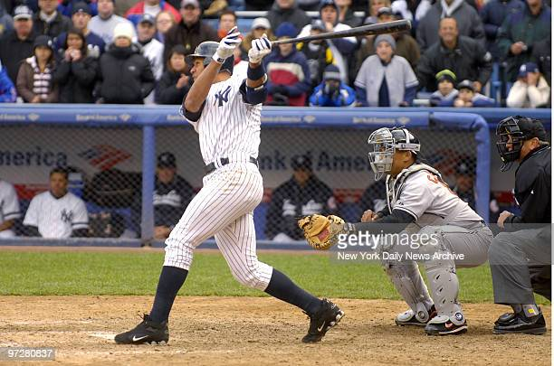 New York Yankees' Alex Rodriguez belts a walkoff grand slam into the black seats of center field with two strikes and two outs in the bottom of the...