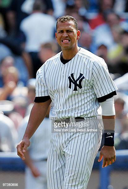 New York Yankees' Alex Rodriguez bites down hard on his chewing gum after he struck out swinging to end the sixth inning of game against the Texas...