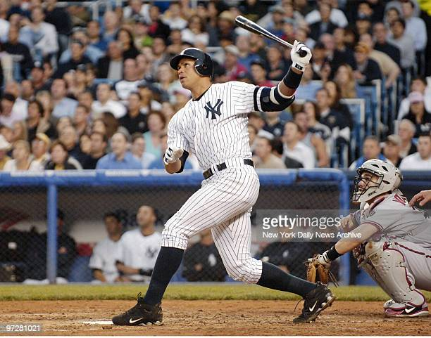 New York Yankees' Alex Rodriguez crushes a tworun homer off the upper deck facade in left field in the third inning of a game against the Arizona...