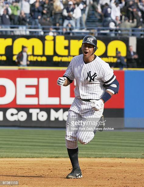 New York Yankees' Alex Rodriguez exults as he rounds the bases after hitting a threerun walkoff homer to center in the bottom of the ninth inning to...