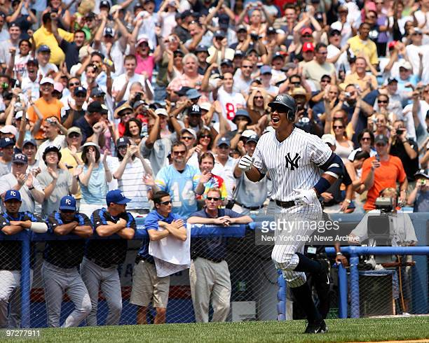 New York Yankees' Alex Rodriguez grins from eartoear against a backdrop of cheering fans as he begins his home run trot after hitting his 500th...
