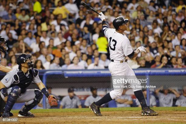 New York Yankees' Alex Rodriguez hits a solo homer in the sixth inning of a game against the Seattle Mariners at Yankee Stadium The Yanks went on to...