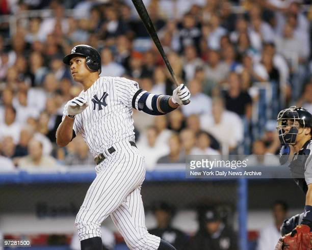 New York Yankees' Alex Rodriguez hits a tworun homer to left in the seventh inning of a game against the Seattle Mariners at Yankee Stadium It was...