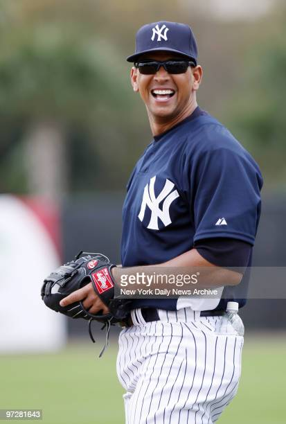 New York Yankees' Alex Rodriguez is all smiles as he fields grounders at third during the first fullsquad workout of spring training at Legends Field