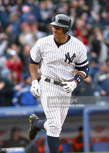 New York Yankees' Alex Rodriguez is all smiles as he trots to first after belting a walkoff grand slam into the black seats of center field with two...