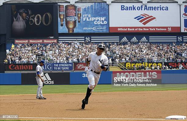 New York Yankees' Alex Rodriguez rounds third base after hiting his 500th home run off a pitch by Kansas City Royals' pitcher Kyle Davies in the 1st...
