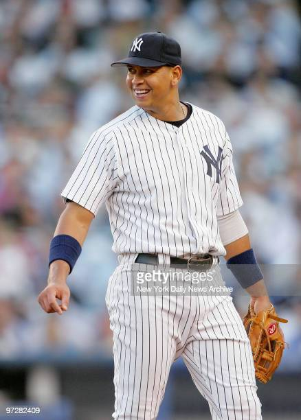 New York Yankees' Alex Rodriguez smiles as he takes his position at third base in the second inning of a game against the Boston Red Sox at Yankee...
